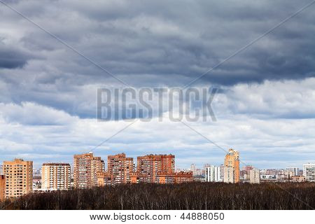 Low Grey Rainy Clouds Under City