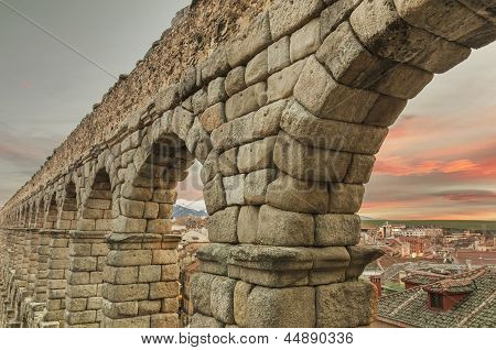 Segovia Aqueduct At Dusk. Famous Spanish Landmark