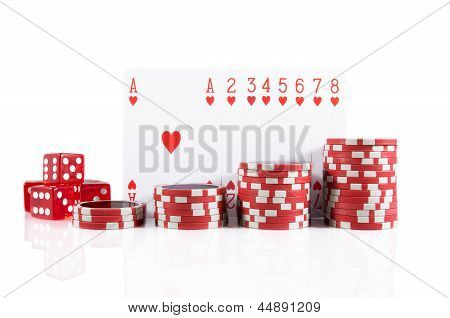 Group Of Poker Cards, Poker Chips, And Red Dice Over White Isolated Background