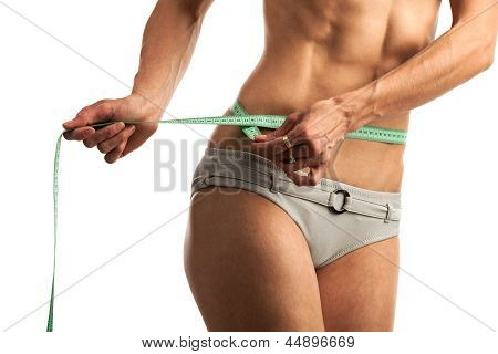 Cropped view of fitness woman with measuring tape