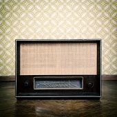 pic of xx  - vintage radio receiver device on the weathered wooden parquet floor in vintage room with old fashioned wallpaper - JPG