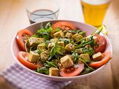 picture of rocket salad  - salad with tofu tomatoes arugula and sesame seeds - JPG