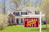 stock photo of real  - Sold Home For Sale Real Estate Sign and Beautiful New House - JPG
