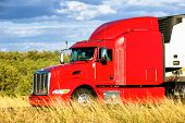 stock photo of moving van  - Red truck moving on a highway in USA - JPG