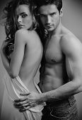 stock photo of nude couple  - Fashion portrait of beautiful young lovers - JPG