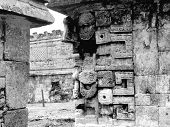 stock photo of conquistadors  - Mayan ruins of Chichen Itza in Yucatan Mexico the Nunnery with Chac Masks - JPG