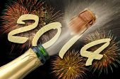 image of sparkling wine  - new year 2014 with popping champagne and firework - JPG