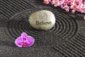 image of spirit  - Japanese zen garden in black sand with stone of believe - JPG