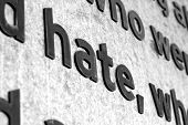 image of hitler  - A detail shot of the word HATE carved into stone - JPG
