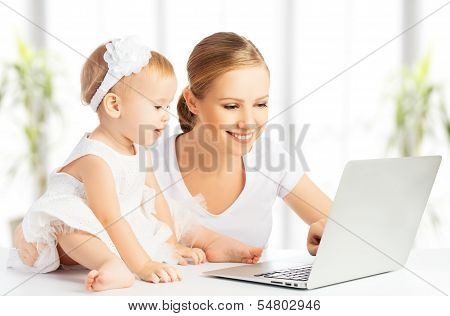 Mom And Baby With Computer Working From Home