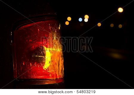 Close Up Of A Taillight Against A Bokeh Background
