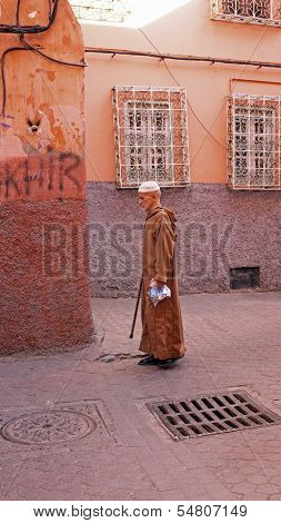 FES, MAROCCO - October 22, 2013 : Man beautifully dressed up on Eid al-Adha. The festival is celebrated by sacrificing a sheep and distributing the meat to relatives, friends, and the poor.