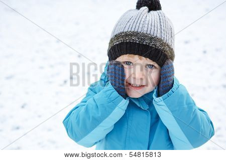 Adorable Toddler Boy Having Fun With Snow On Winter Day