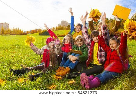 Many Friends Sit On Autumn Lawn