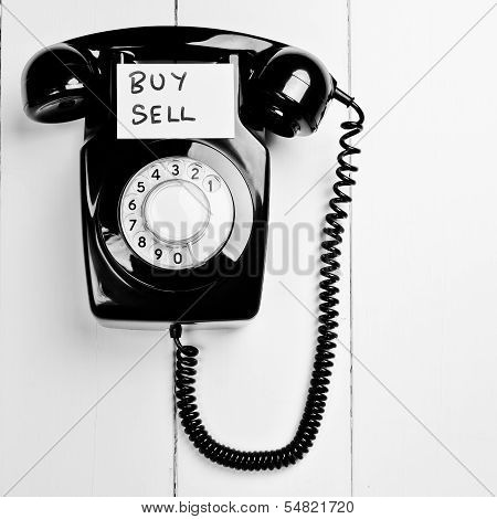 Retro Phone With Buy Sell Note, Stock Market Trading Concept