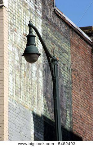 Street Light And Brick Wall