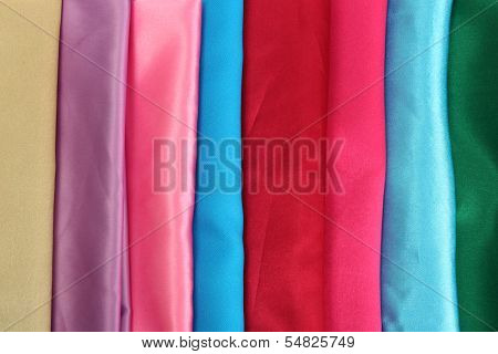 heap of cloth fabrics, close up
