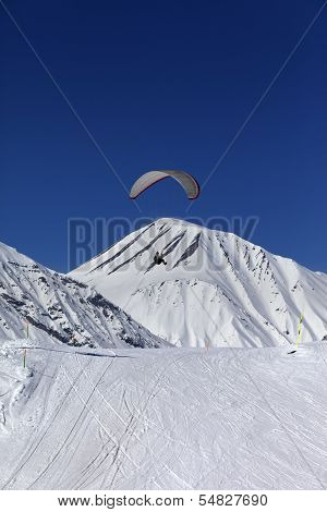 Skydiver In Sunny Snowy Mountains