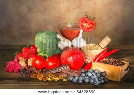 Display of fruits and vegetables on a wooden table filled with antioxidants