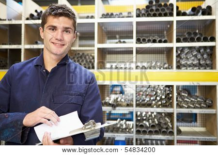 Apprentice Checking Stock Levels In Store Room