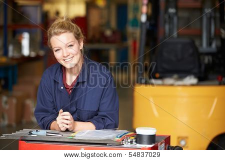 Portrait Of Apprentice Engineer In Factory
