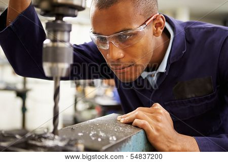 Apprentice Engineer Using Milling Machine