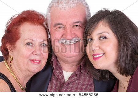 Close Portrait Of Senior Couple And Their Daughter On Fathers Day