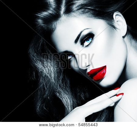 Sexy Beauty Girl with Red Lips and Nails. Provocative Make up. Luxury Woman with Long Hair. Fashion Brunette Model Black and White Portrait isolated on Black background. Gorgeous Woman Face.