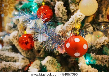 Red Dotty Ball Decorated On A Christmas Tree