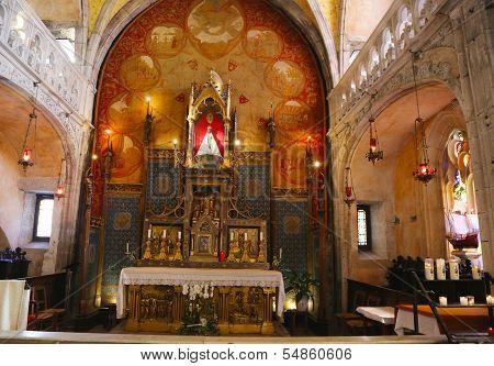Wooden Black Madonna inside of church of Notre Dame in Rocamadour, France