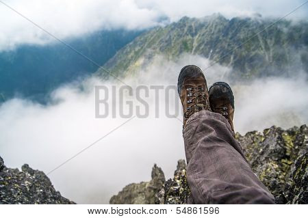 Hiker resting in the high mountains