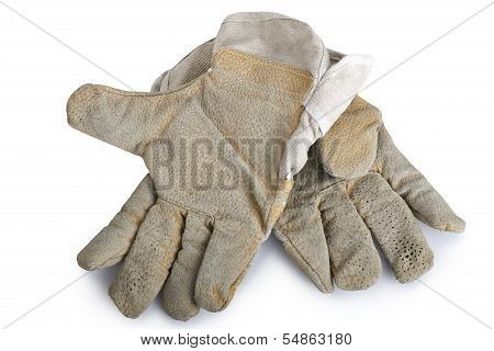 Dirty And Well-worn Pair Of Canvas And Leather Work Gloves On White Background.