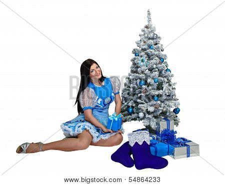 Attractive Girl Near Christmas Tree And Gifts