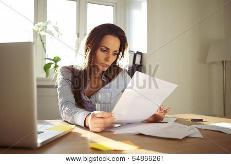 Businesswoman Reading A Document poster