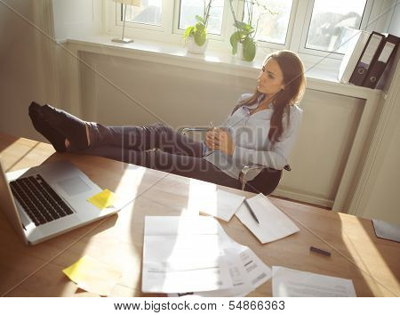 Young Woman Taking A Break From Work