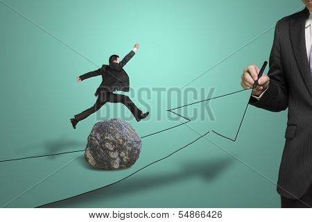 Businessman Drawing Road With Arrow, Another Jumping Over Rock