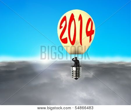 Man Taking Lamp Balloon Floating Over Clouds, Looking At Sun