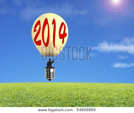 Man Taking Lamp Balloon Floating Over Meadow And Looking At