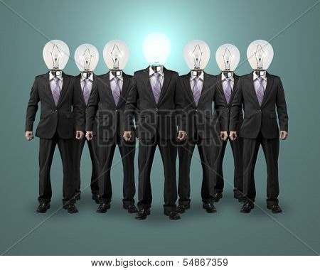 Lighting Bulb Head Businessman Standing With Group