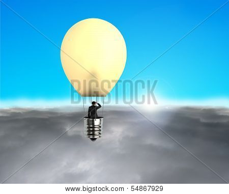 Man Taking Glowing Lamp Balloon Flying Over Clouds