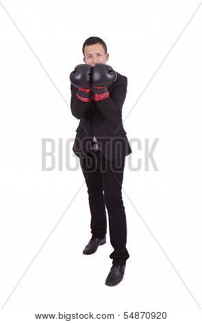Handsome young businessman posing with boxing gloves