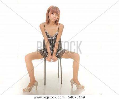 Asian Woman In Black And White Underwear Sitting On Stool