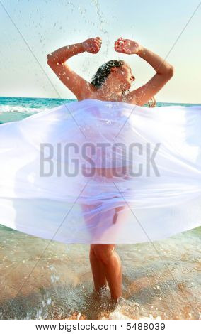 Young Attractive Girl In Water Drops On Sea Background