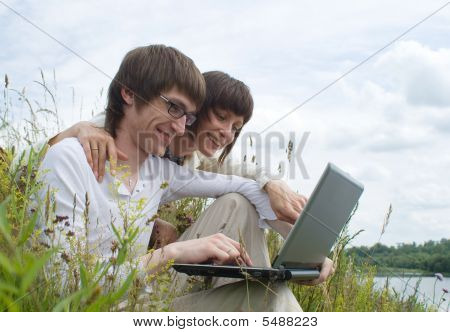 The Man And Women With Laptop