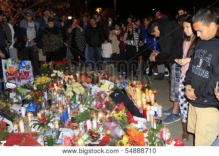 SANTA CLARITA - DEC 1: Fans pay tribute to actor Paul Walker at the site of his fatal car accident on December 1, 2013 in Santa Clarita, California