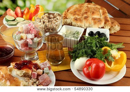 Traditional Turkish breakfast on table on bright background