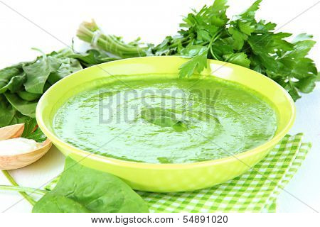 Tasty spinach soup, on white table