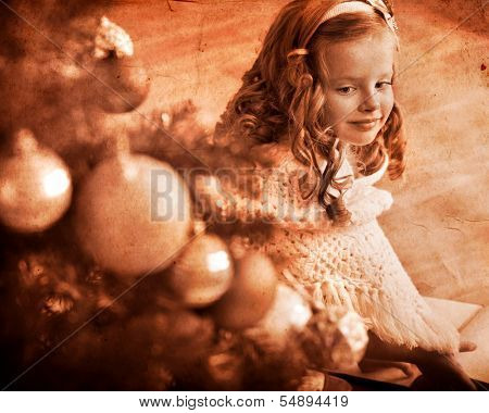 Child  receiving gifts under Christmas tree. Black and white retro.