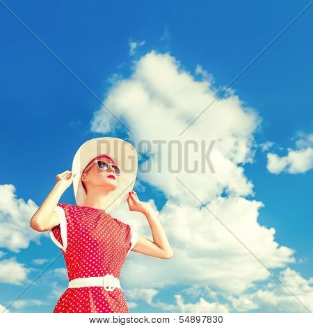 retro girl on the blue sky background