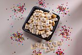 stock photo of scrabble  - Sweet square cookies with letters to placing scrabble - JPG